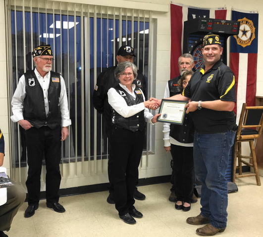 Linda presenting Certificate of Appreciation to American Legion Commander, Justin Carpenter, Lewis and Clark Post No. 2.