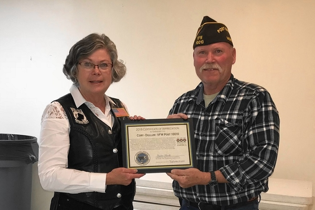 Linda presenting Certificate of Appreciation to Commander Tom Johnson of VFW Post 1001010010